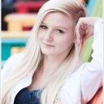 Downtown Reno Teen Portraits - young woman modeling on colorful chairs