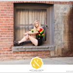 Downtown Reno Teen Portrait - young woman modeling in window on brick building