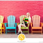 Downtown Reno Teen Portrait - young woman modeling on chairs in front of red building