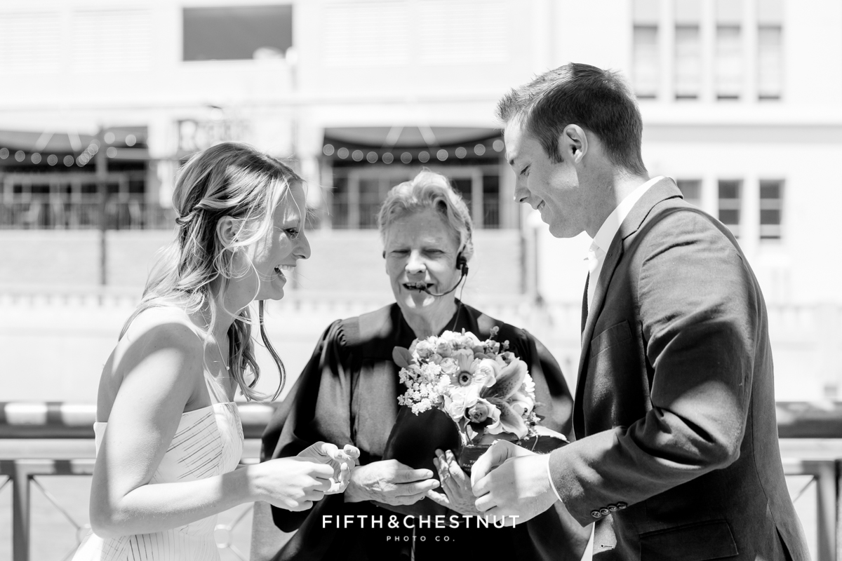 Exchanging of the rings during a Downtown Reno elopement by Reno Wedding Photographer