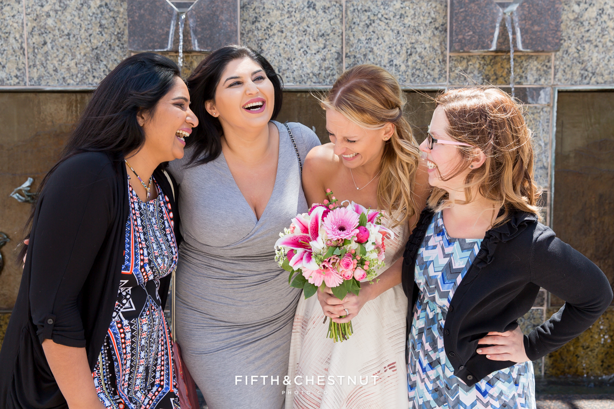 Friends laughing with bride at her Downtown Reno elopement by Reno Wedding Photographer