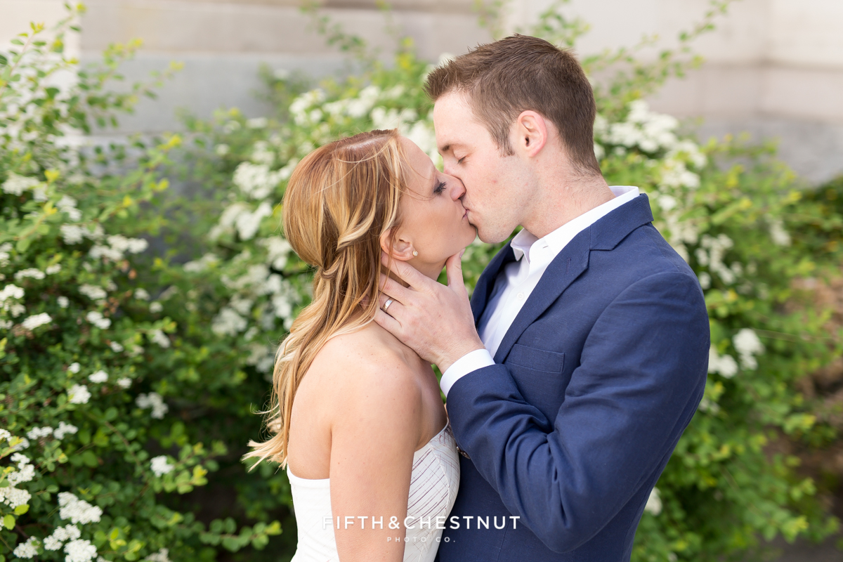 Bride and groom kiss during a Downtown Reno elopement by Reno Wedding Photographer