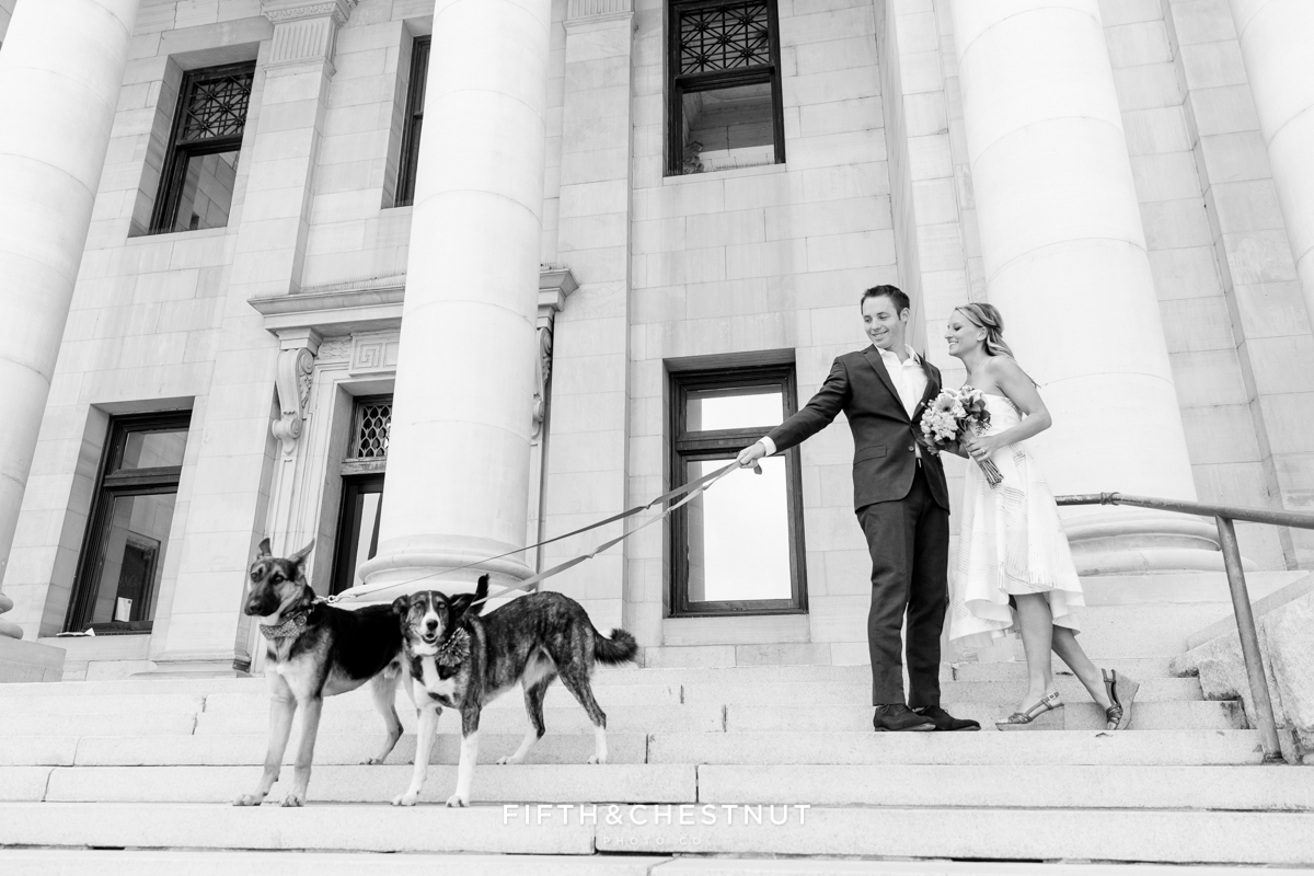 Black and white photo of bride and groom at courthouse for a Downtown Reno elopement by Reno Wedding Photographer