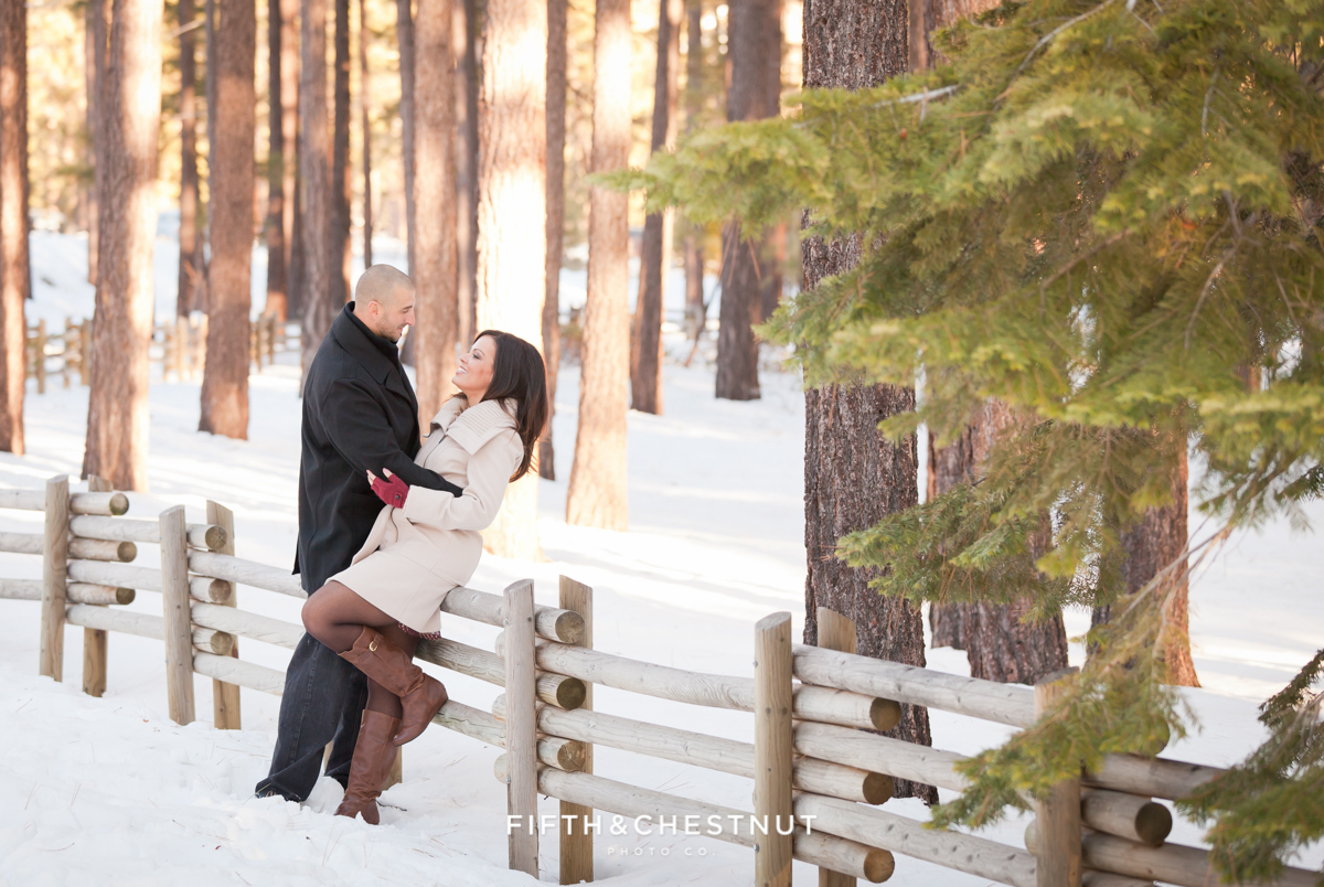 Nevada Beach Portraits of Engaged Couple in Winter by Lake Tahoe Wedding Photographer
