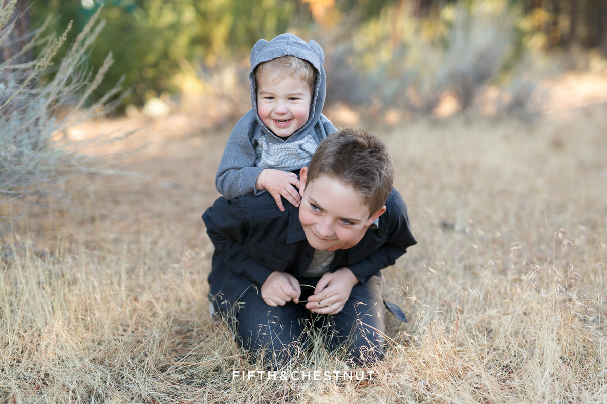 Sons of Reno Family Photographer play together at Callahan Park in Reno