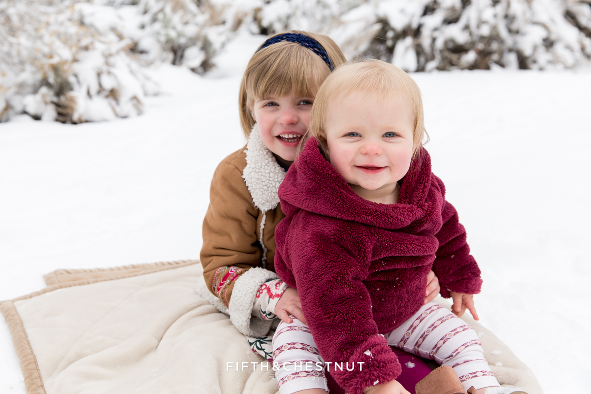 Winter Family Portrait of siblings in snow by Reno Family Photographer