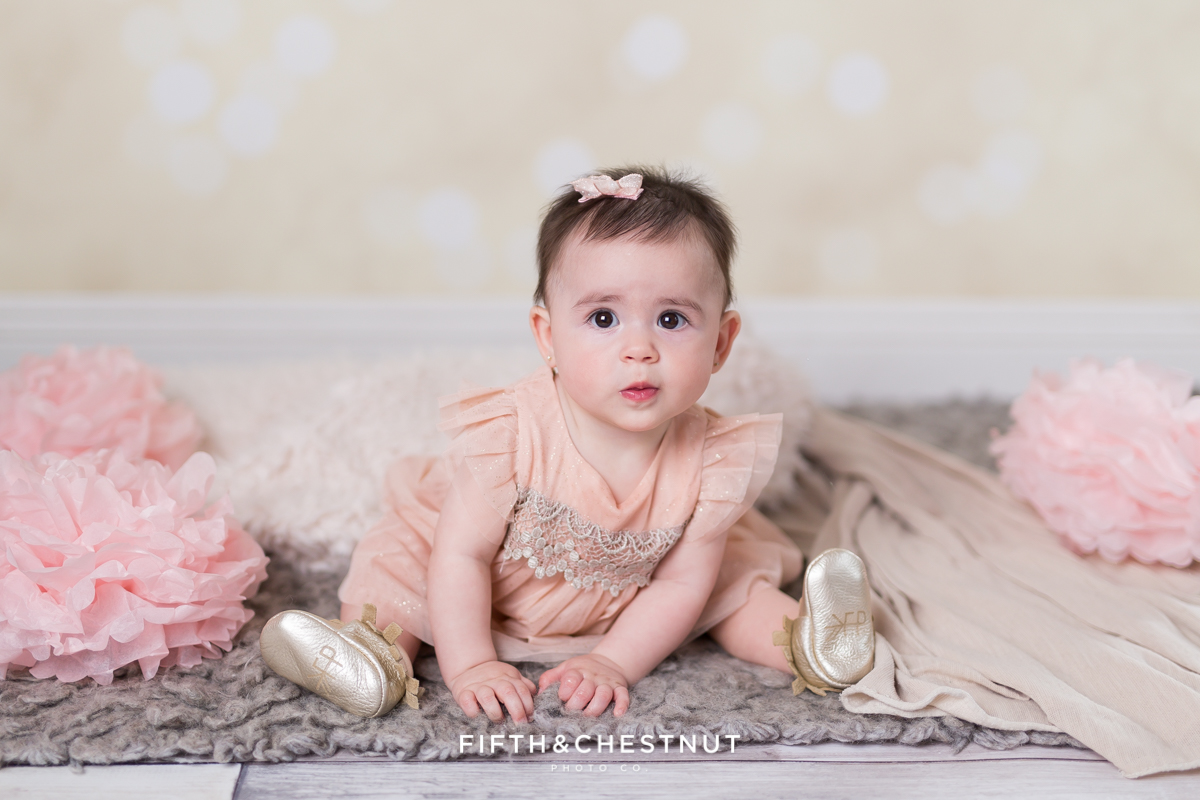 Baby Girl wearing a glittery pink dress for portraits by Reno Baby Photographer Fifth and Chestnut