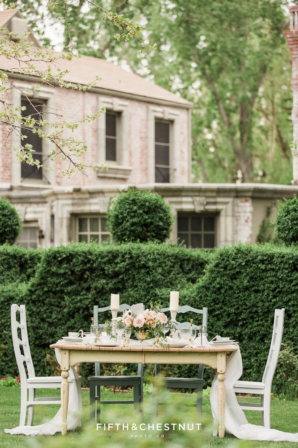 A dusty blue country french wedding tablescape at a private estate