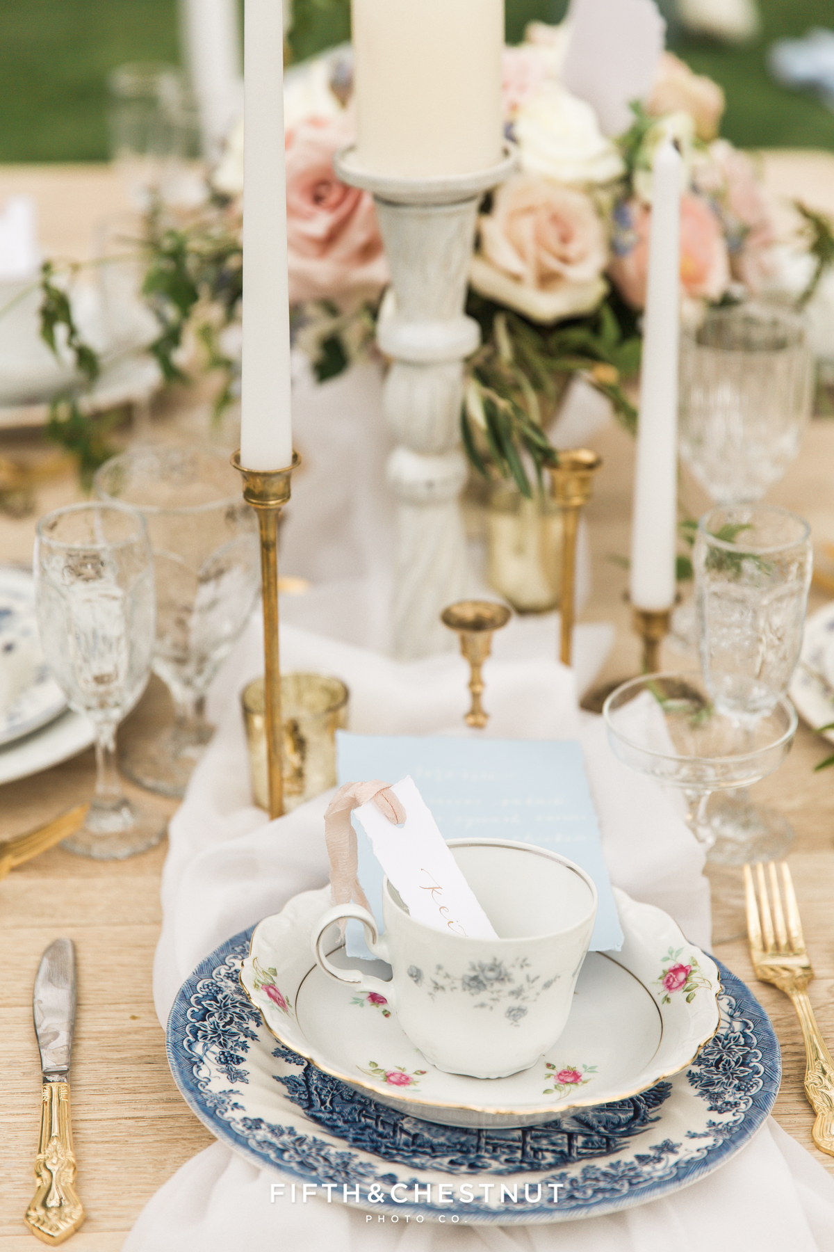 Place setting details with mismatched gold edged plates for a Dusty Blue Private Estate Country French Wedding Styled Shoot