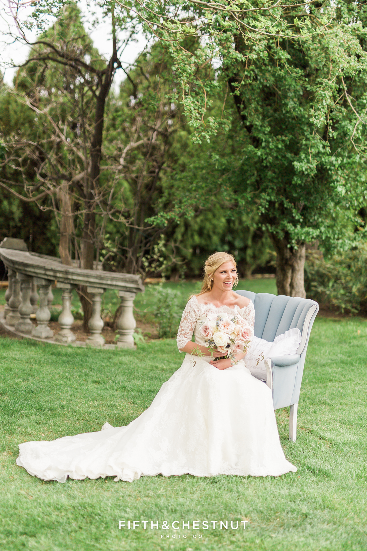 Bride sitting on dusty blue country french chaire at a private estate in Reno, NV