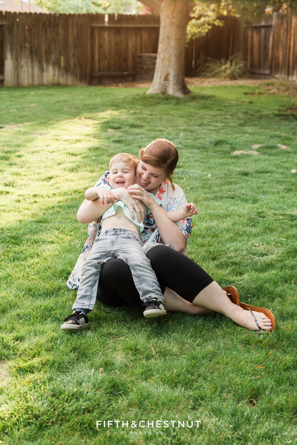 Reno Family Photographer mom tickling her toddler son on a spring day