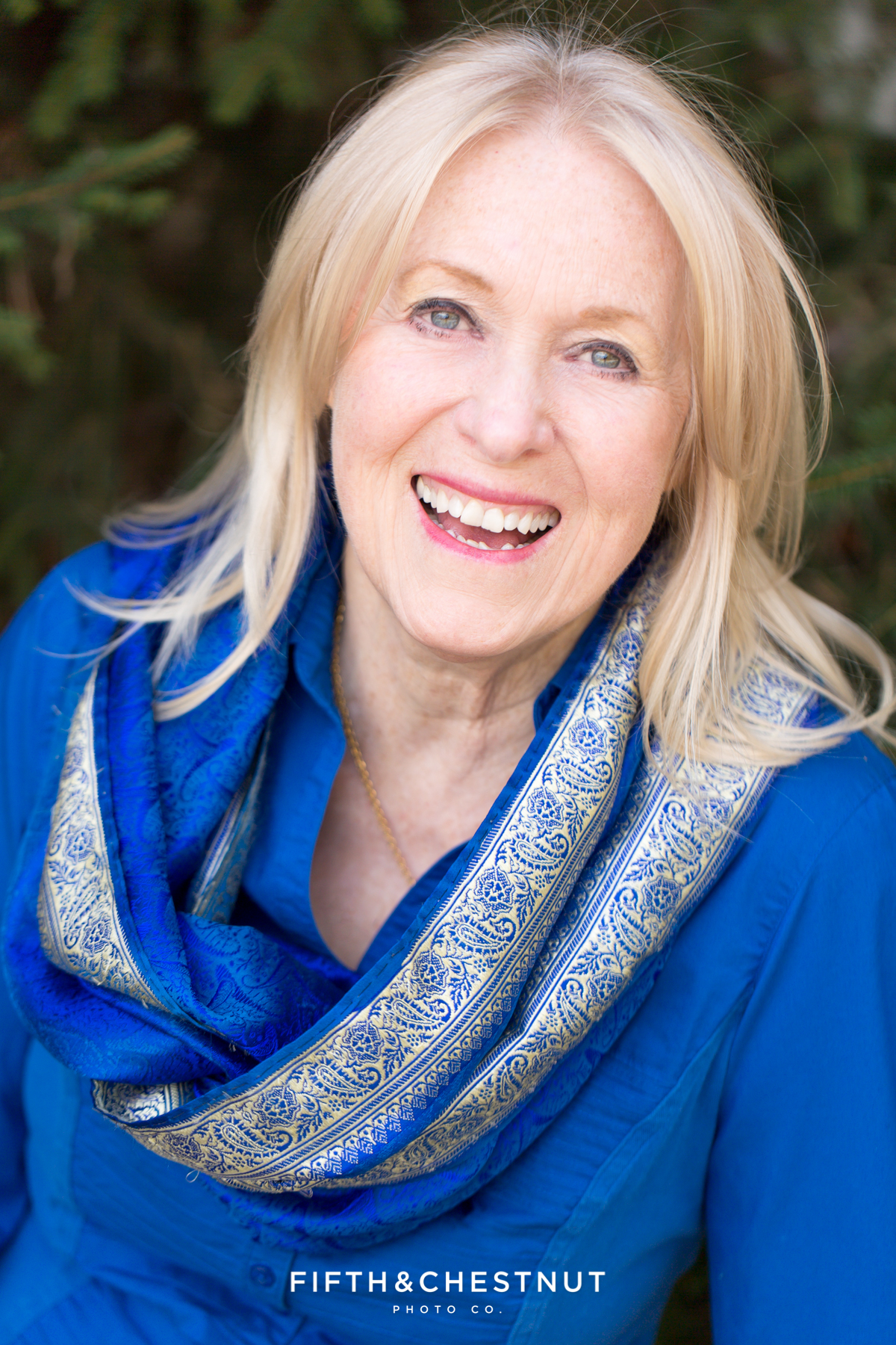 Author headshot in blue scarf by Reno Headshot Photographer
