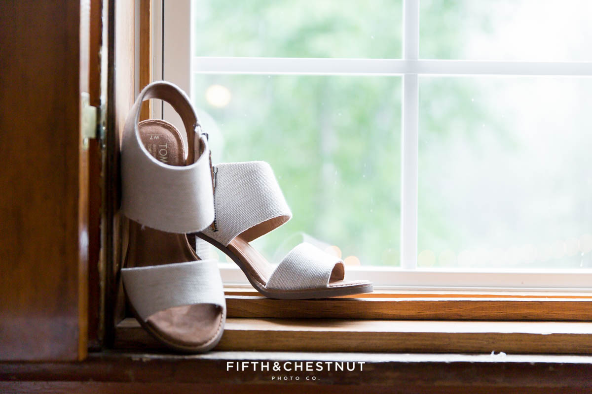 Tom's wedding shoes sit on a windowsill before a Twenty Mile House wedding