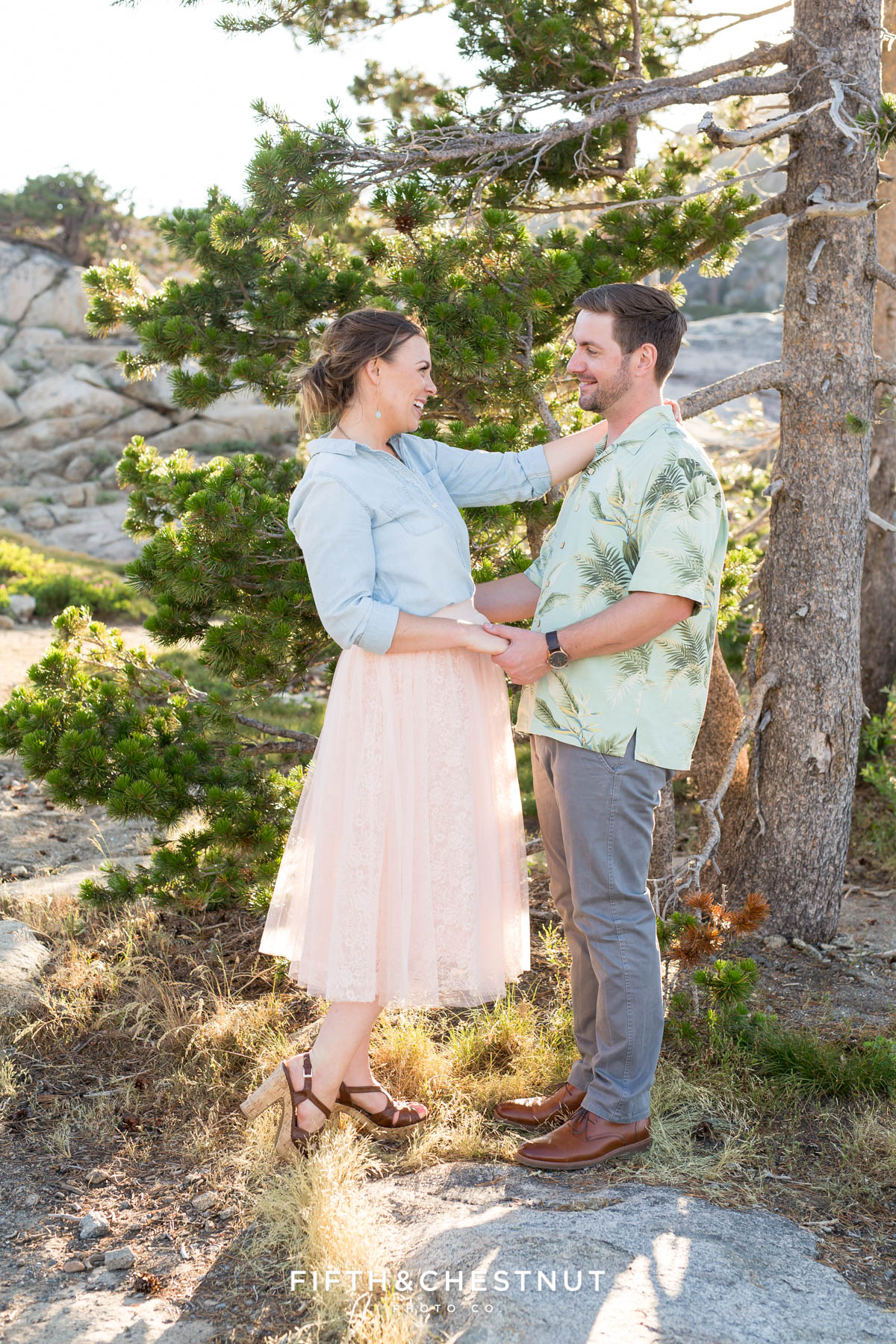 Couple embraces and looks at each other during their Donner Lake Engagement session with Quincy Wedding Photographer