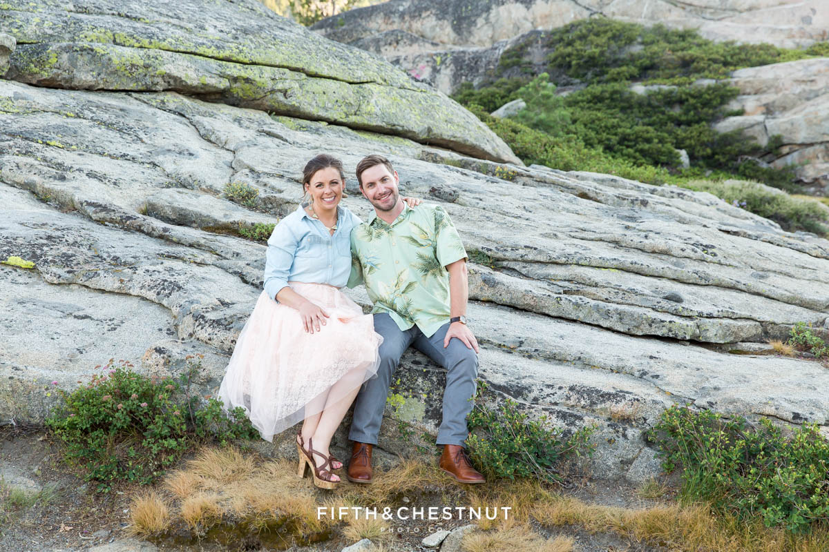 Engaged couple relaxing together on rocks for their Donner Lake Engagement session by Quincy Wedding Photographer