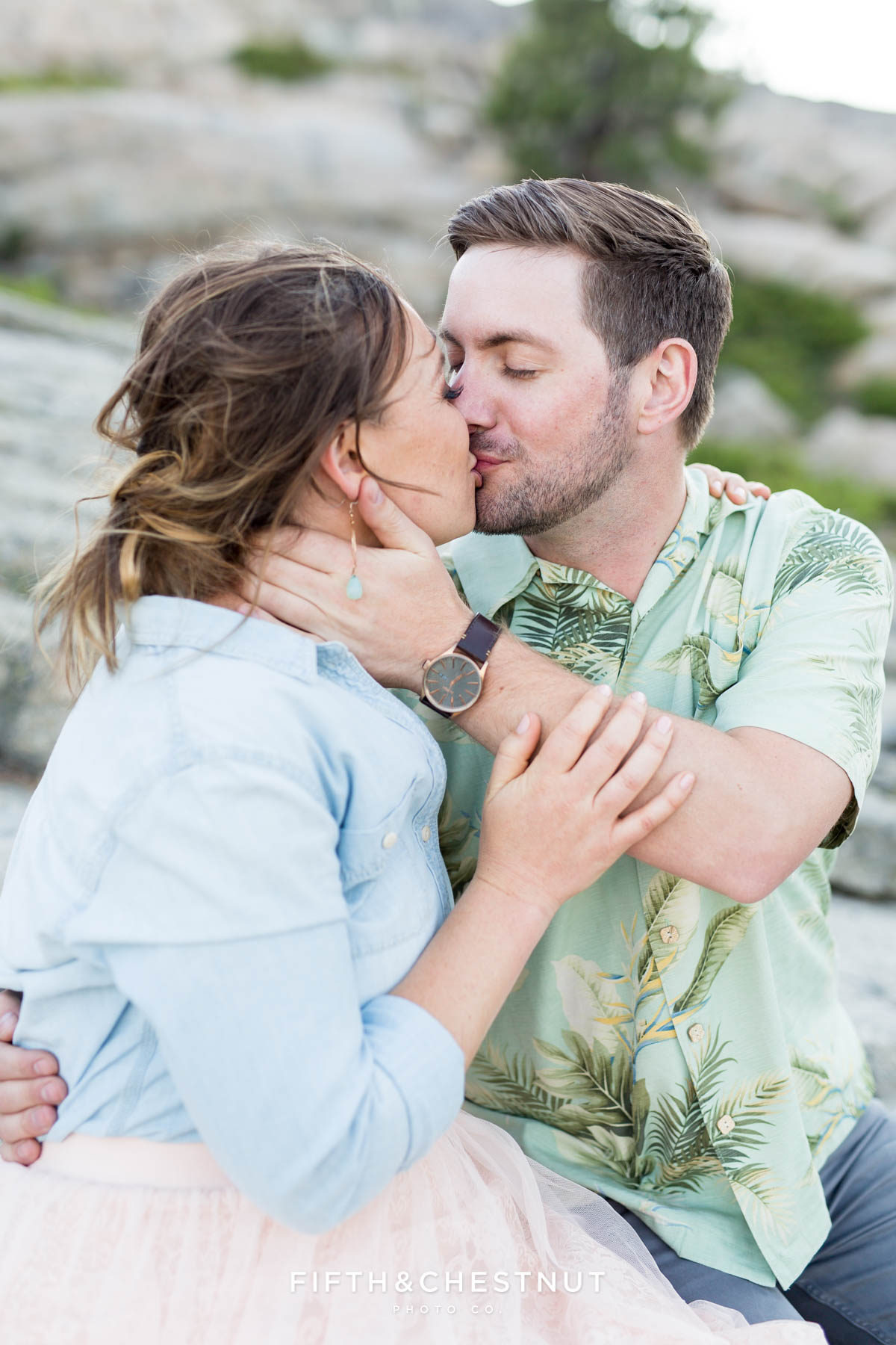 Engaged couple kissing for their Donner Lake Engagement