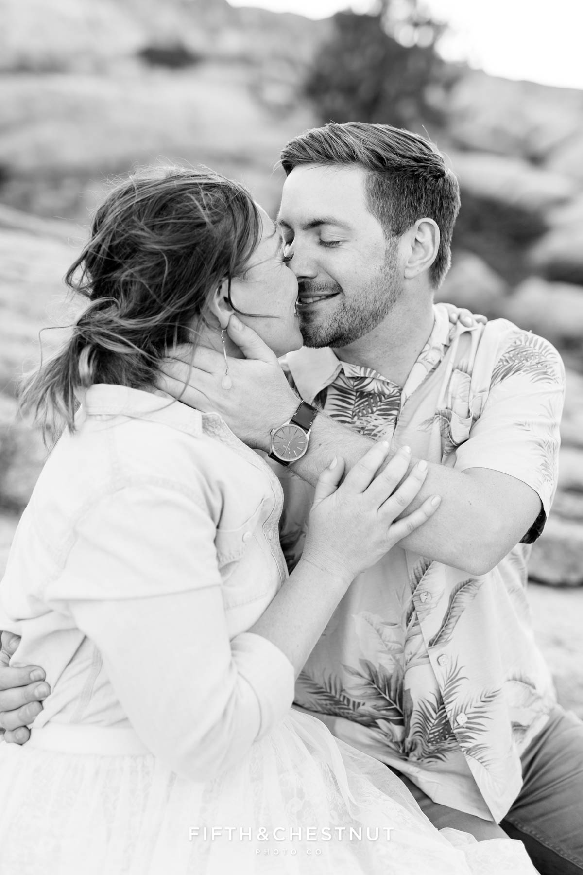 black and white photo of an engaged couple right after a slow sweet kiss