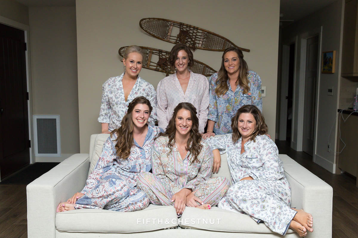 Bride and her bridesmaids in floral mismatched pajamas before they get dressed for a beautiful North Lake Tahoe Wedding by Lake Tahoe Wedding Photographer