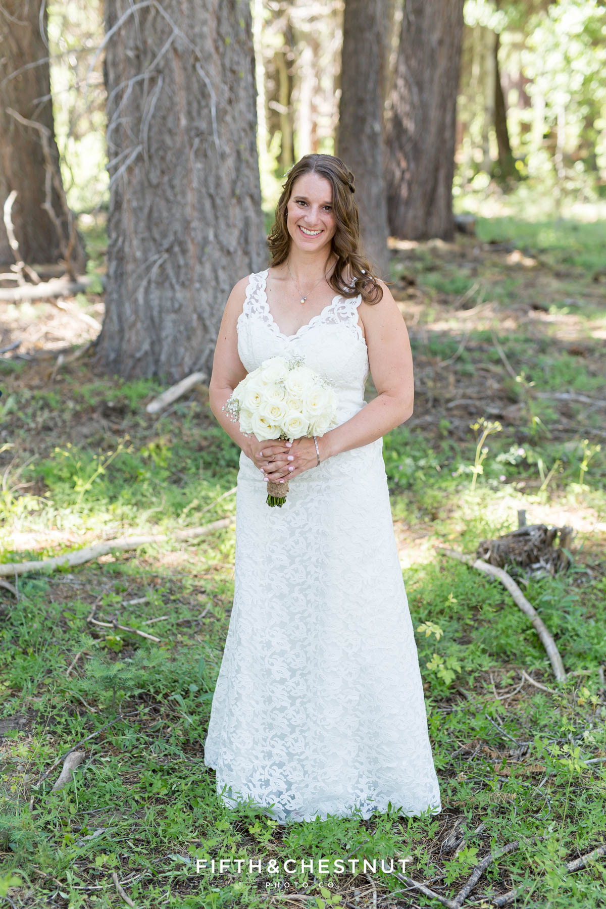 Bride holds rose wedding bouquet in her custom Ecuadorian wedding gown before her North Lake Tahoe Wedding