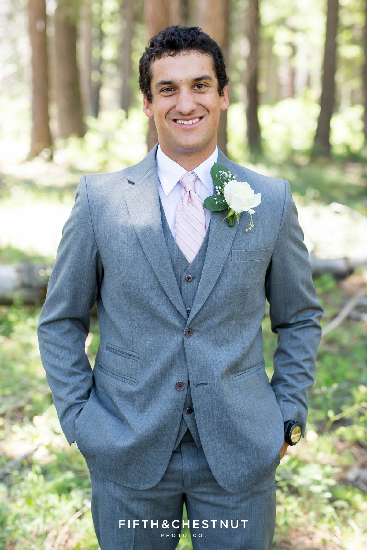 Portrait of groom wearing a gray suit and pink tie before his North Lake Tahoe Wedding