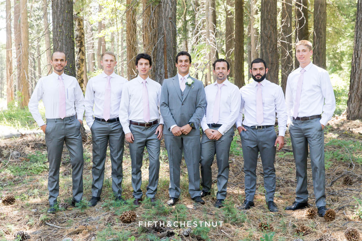 groom poses with his groomsmen in gray for his North Lake Tahoe Wedding