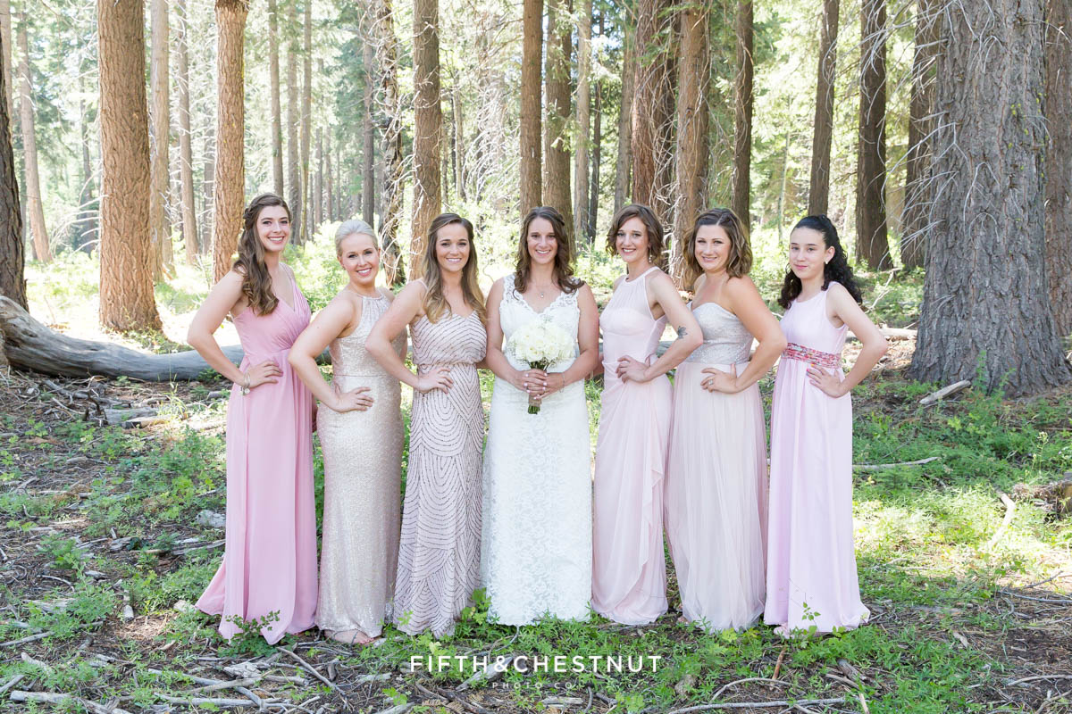 Bride poses with her bridesmaids in pink for her North Lake Tahoe Wedding