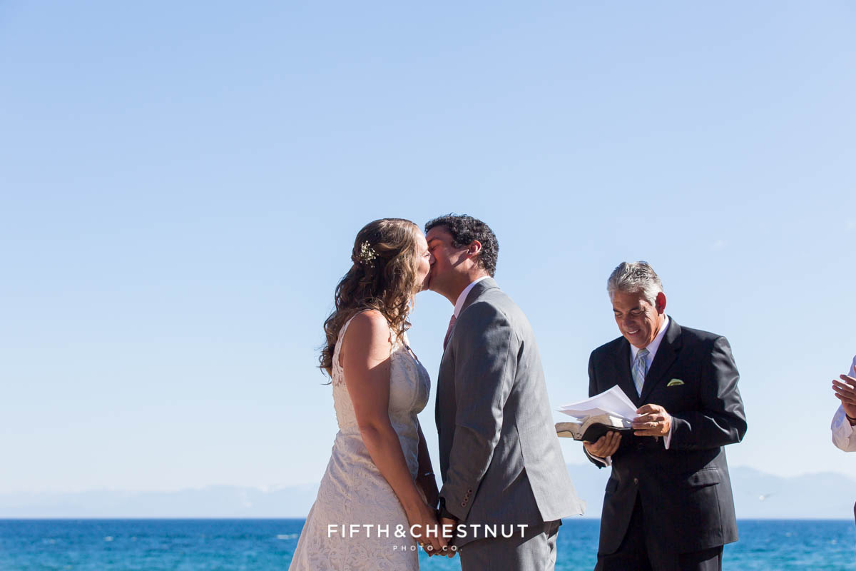 Bride and groom's first kiss and husband and wife at their North Lake Tahoe Wedding by Tahoe Photographer