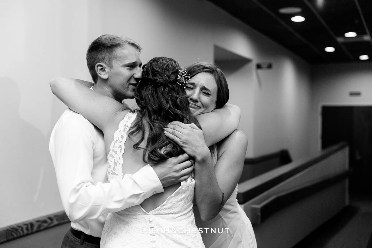 Bride embraces her brother and sister after her wedding ceremony in lake tahoe