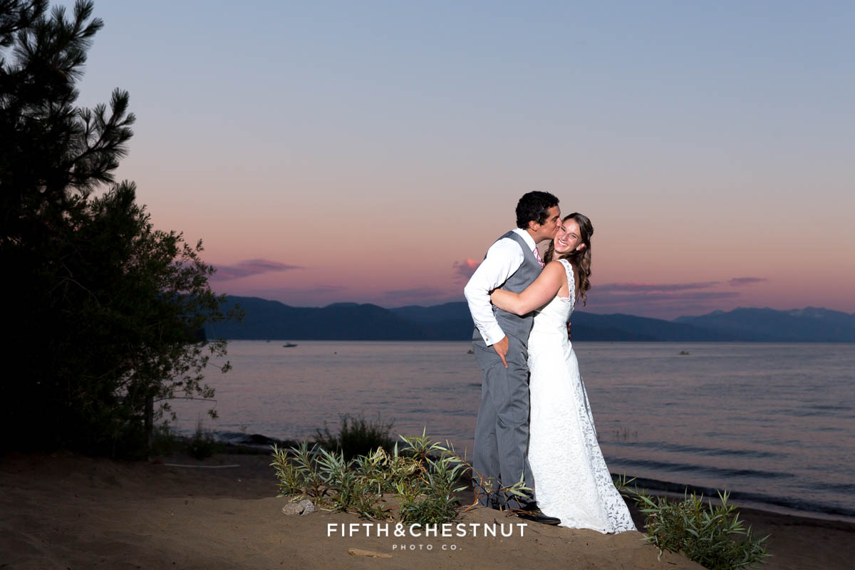 Bride and groom embrace on the beach for a sunset photo at their North Lake Tahoe Wedding by Tahoe Photographer