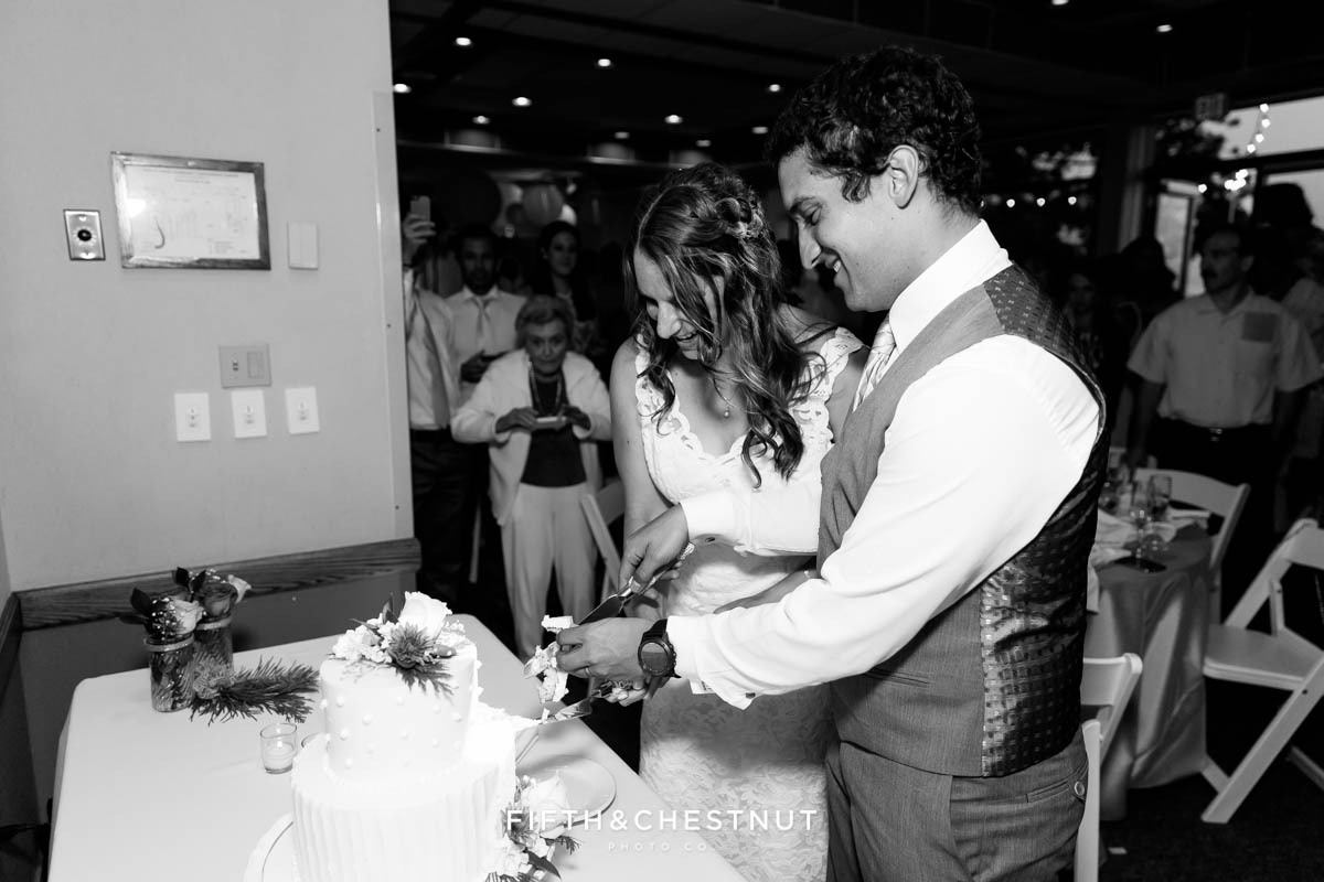 Bride and groom cut the cake at their North Tahoe Event Center Wedding