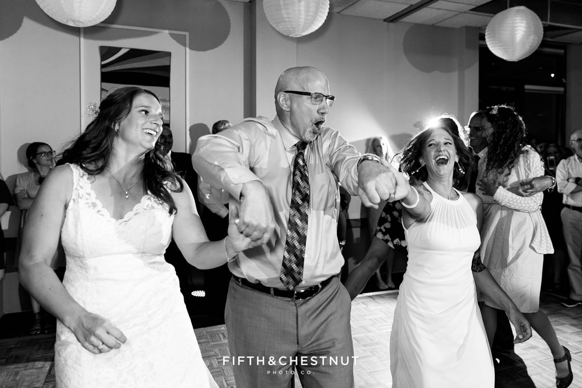 Father dances with his daughters at a North Tahoe Event Center Wedding