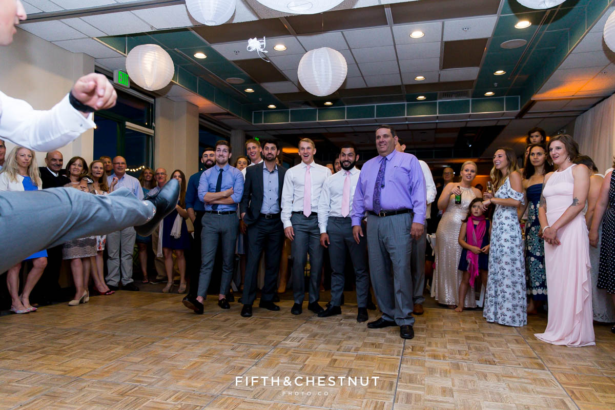 Groom kicks the garter to the single guys at his North shore wedding