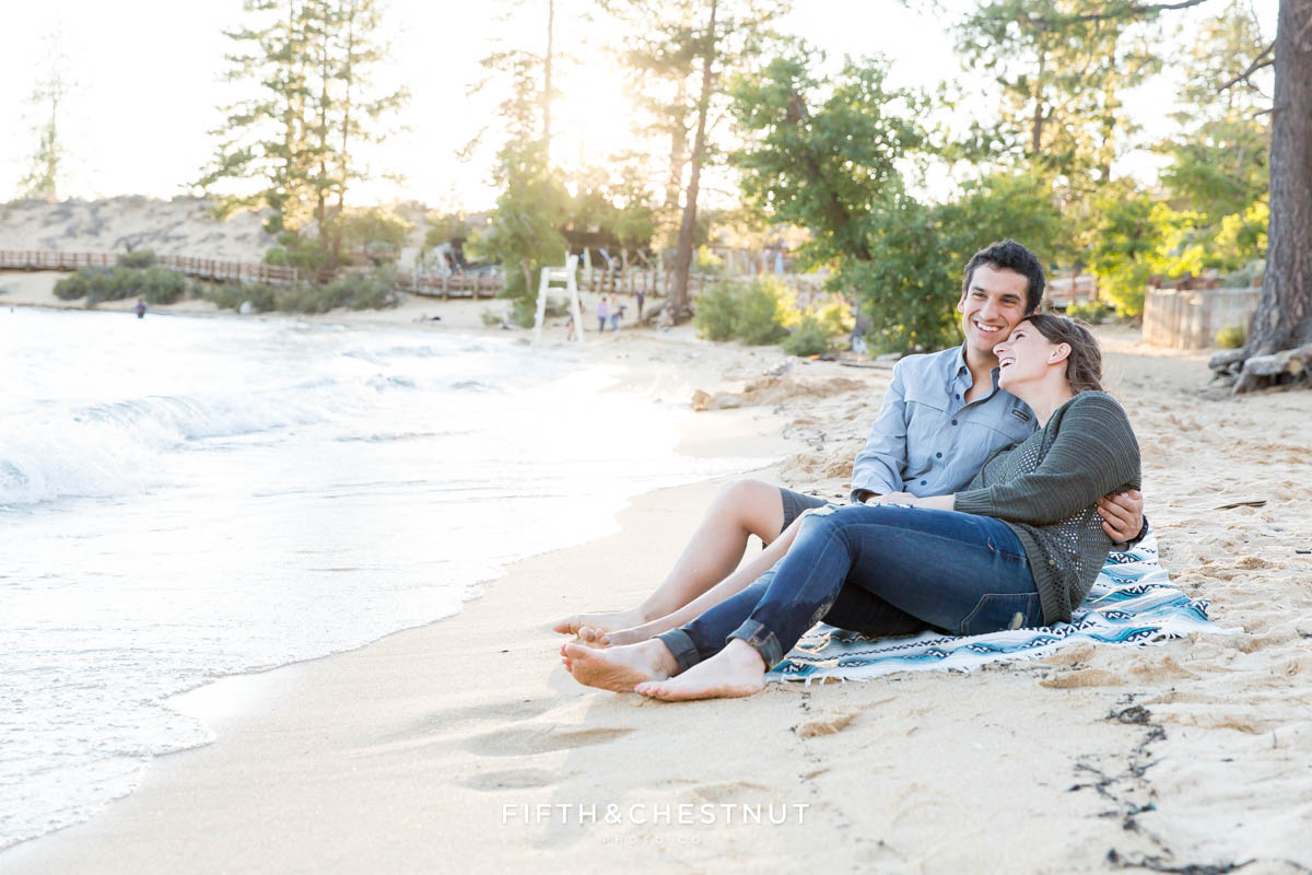 couple laughs on the beach for their engagement photos by Lake Tahoe Photographer