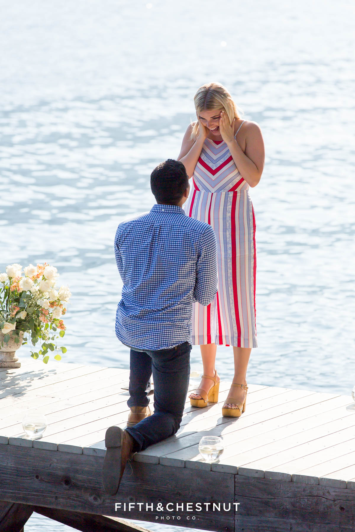 Man surprises girlfriend with a romantic proposal on Donner Lake on a warm summer day
