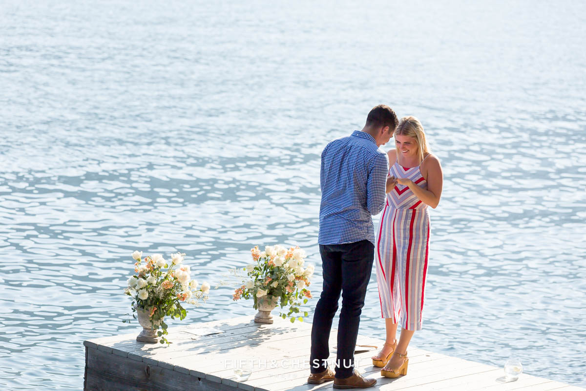 A Donner Lake Proposal on a decorated pier by L Squared Affairs