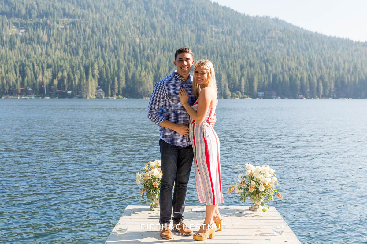 Couple poses for portrait on decorated dock after they became engaged