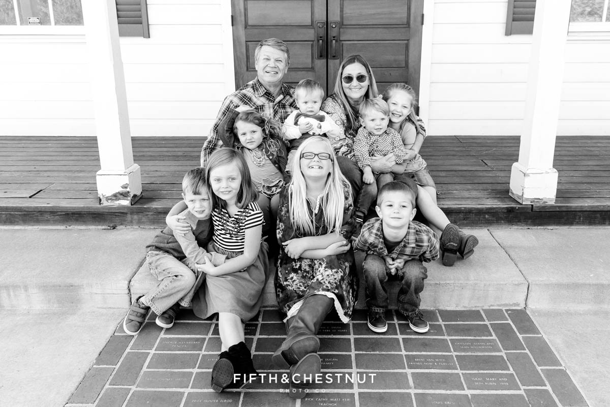 grandparents and all of their grandkids pose for Bartley Ranch Portraits by Reno Family Photographer