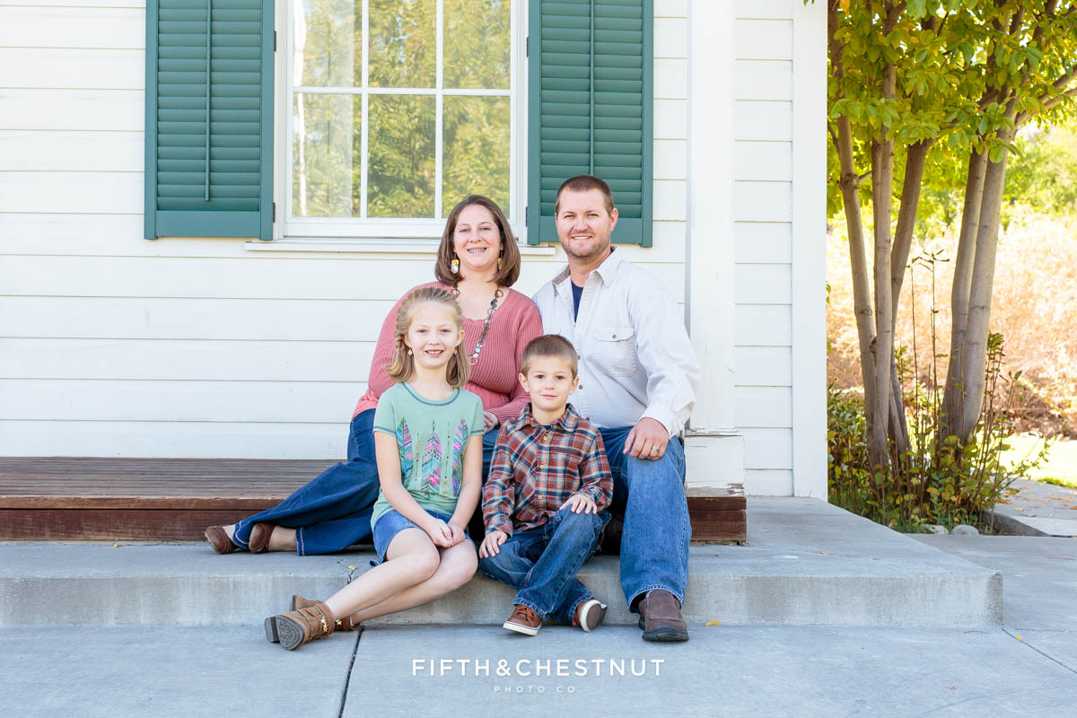 Family of four sits on old huffaker school steps for Bartley Ranch Portraits by Reno Family Photographer