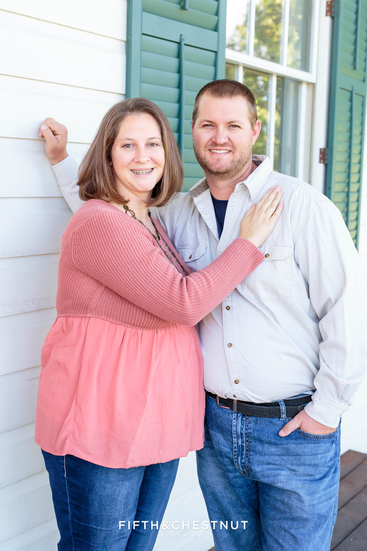 a couple stands on the patio of the old huffaker school for Bartley Ranch Portraits by Reno Family Photographer
