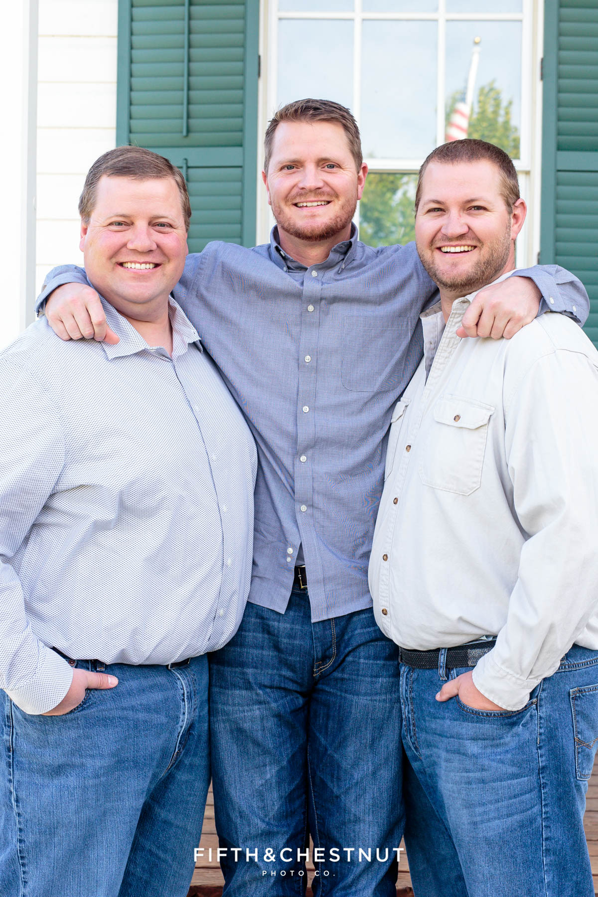 three brothers with their arms wrapped around each other for Bartley Ranch Portraits by Reno Family Photographer