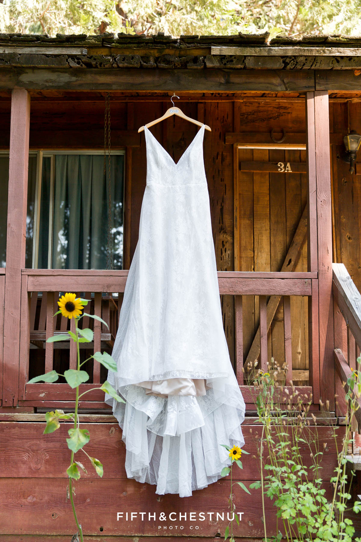 wedding dress hanging on cabin before a Greenhorn Creek Guest Ranch Wedding