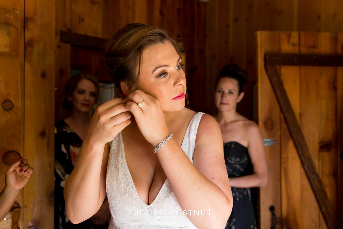bride putting on her earrings for her Greenhorn Creek Guest Ranch Wedding