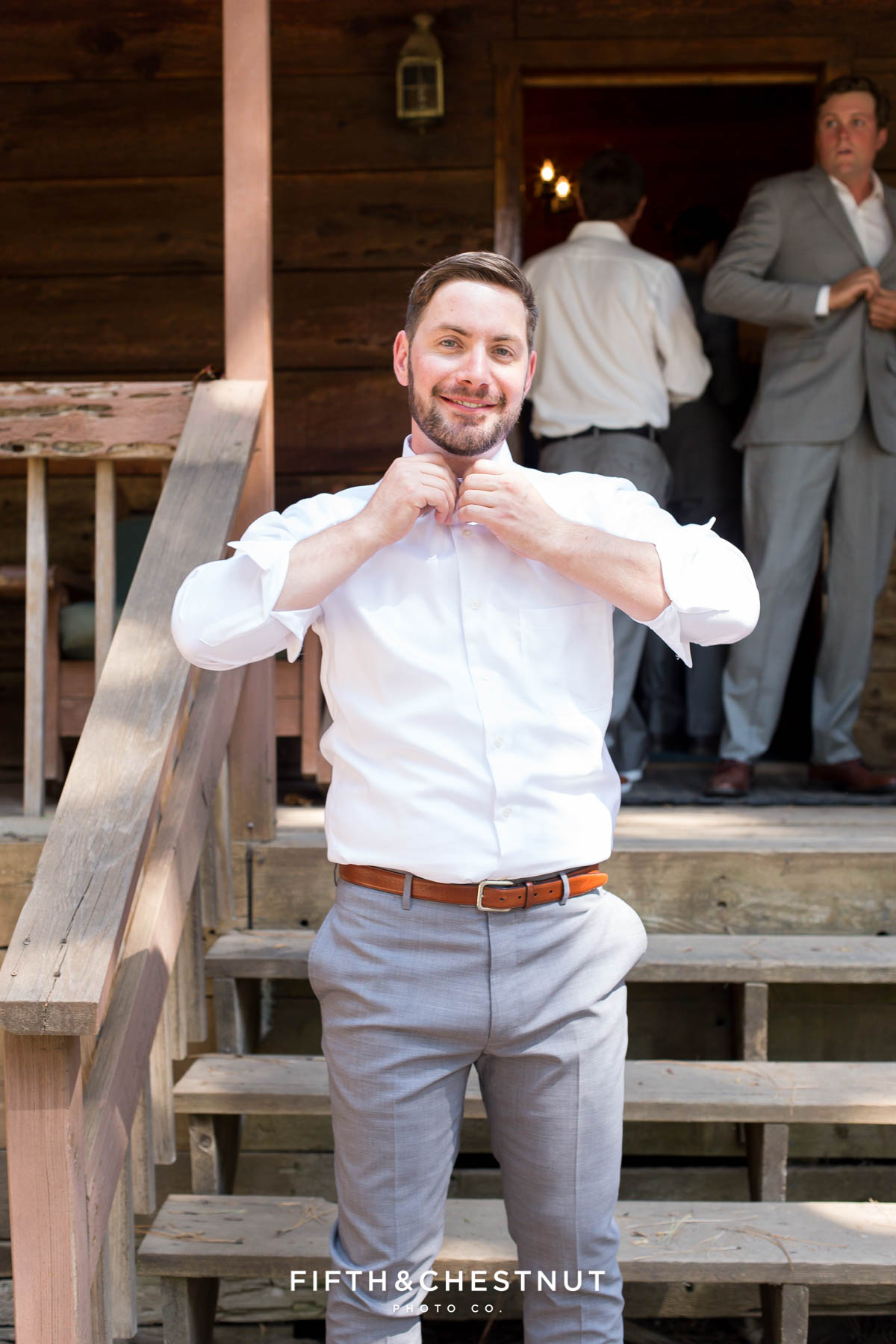 groom prepares for his Greenhorn Creek Guest Ranch Wedding in front of his cabin