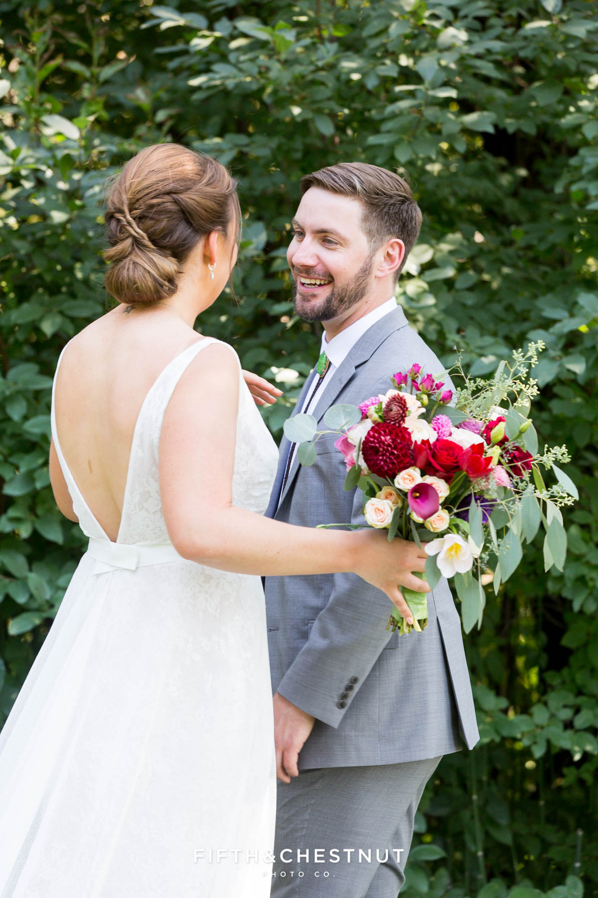 groom turns to see his bride for a first look at a Greenhorn Creek Guest Ranch Wedding