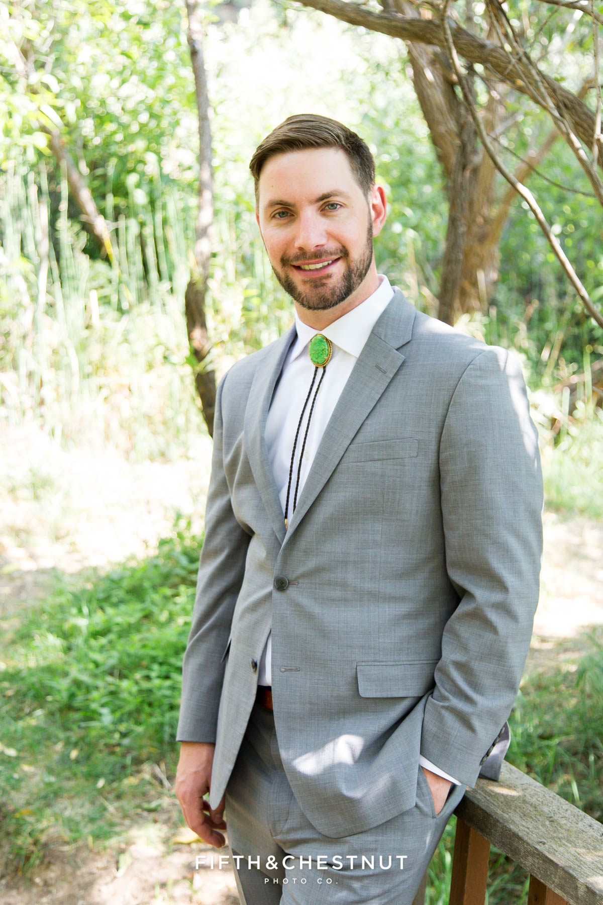 groom portrait under trees for his bright and summery wedding bouquet for a Greenhorn Creek Guest Ranch Wedding