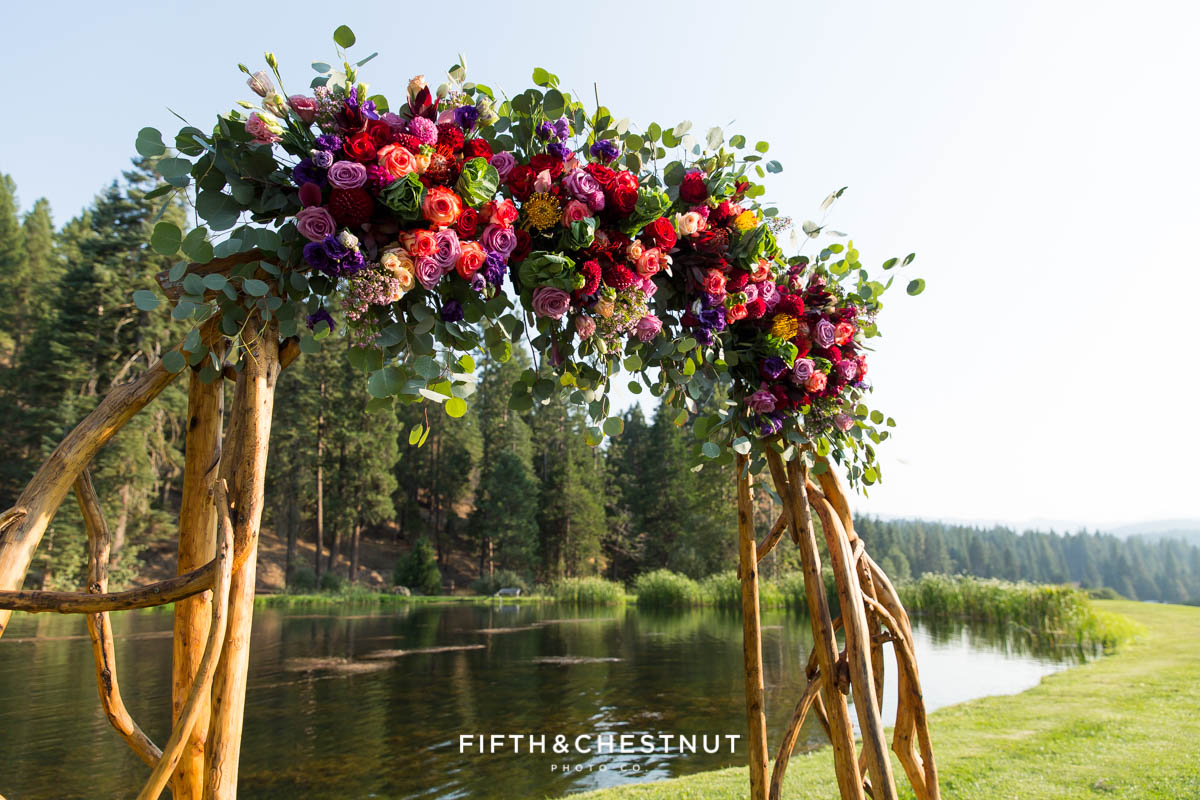 wedding arch details with bright summer flowers