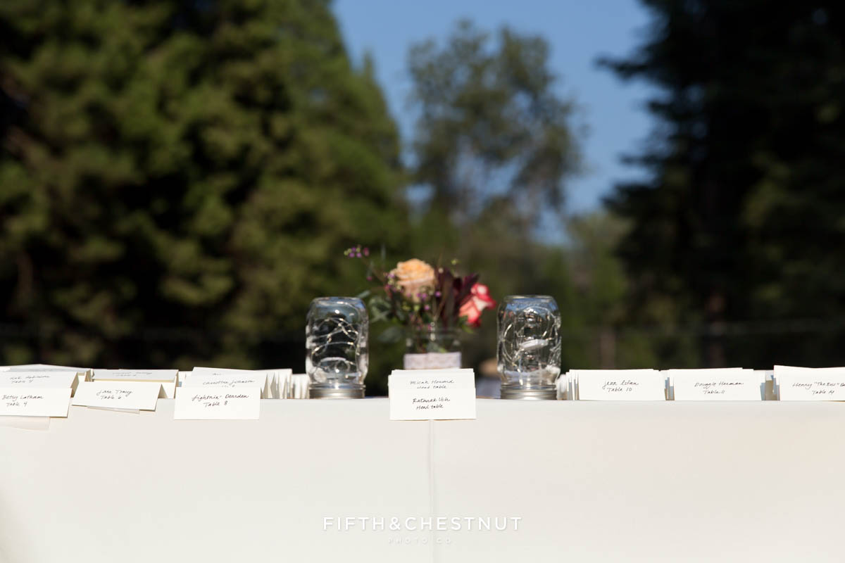 table numbers for a wedding party in gray suits and floral dresses for a bright and summery wedding bouquet for a Greenhorn Creek Guest Ranch Wedding