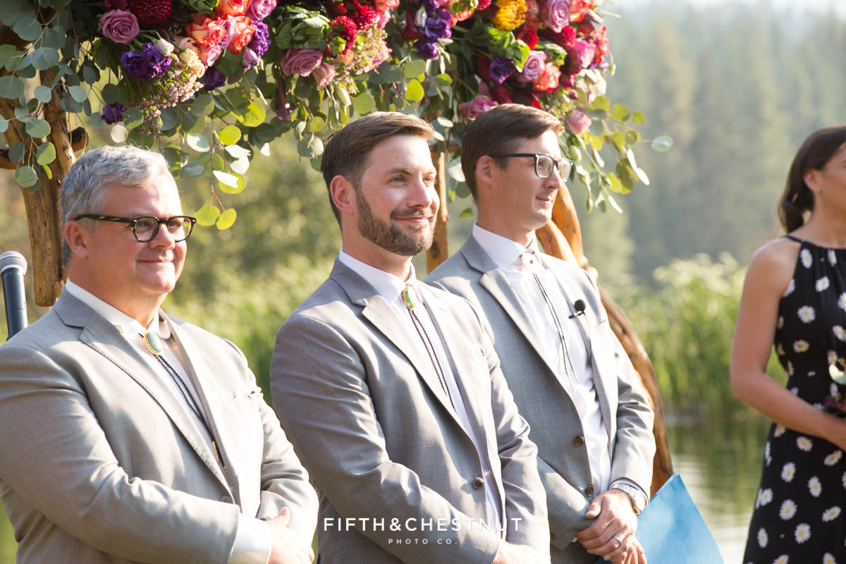 groom sees his bride walking down the aisle for their Greenhorn Creek Guest Ranch Wedding