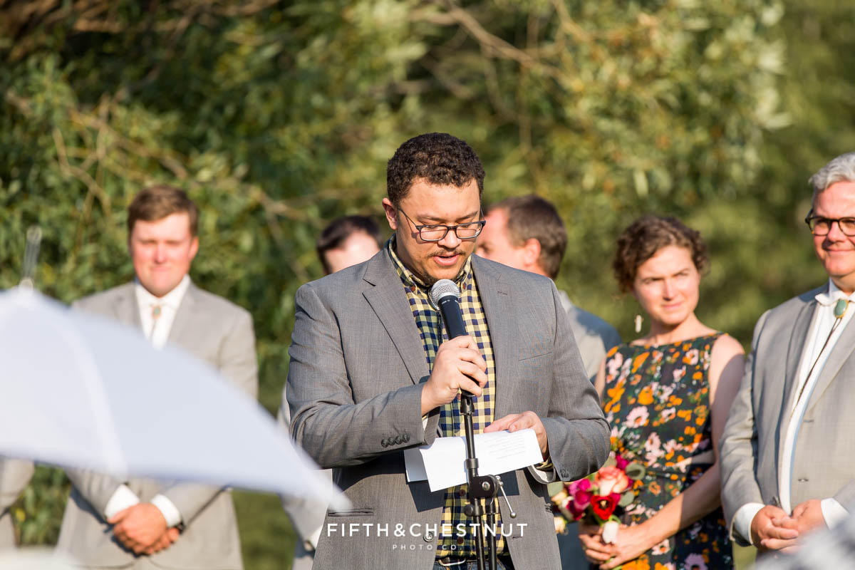 guest in yellow checkered shirt gives speech during a Greenhorn Creek Guest Ranch Wedding