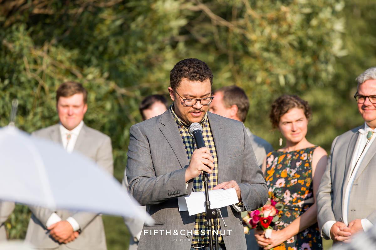 guest in yellow checkered shirt gives speech during a Greenhorn Creek Guest Ranch Wedding